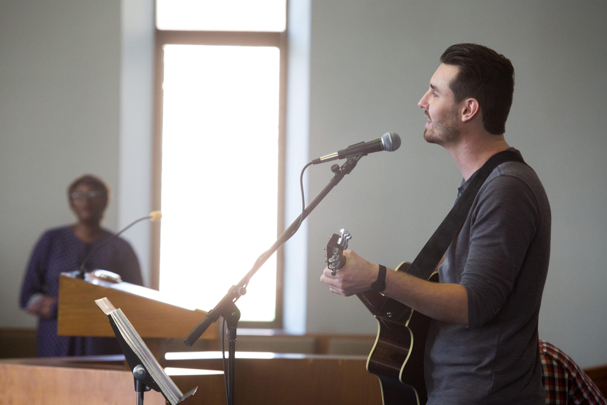 Student Singing at an Emmanuel Chapel Service